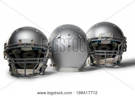 Sports helmet arranged side by side on white background
