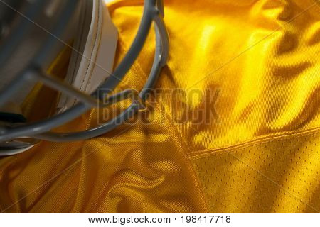 High angle view of sports helmet on yellow jersey