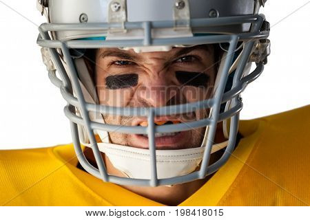 Close-up portrait of aggressive American football player wearing helmet