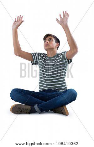 Thoughtful teenage boy praying against white background