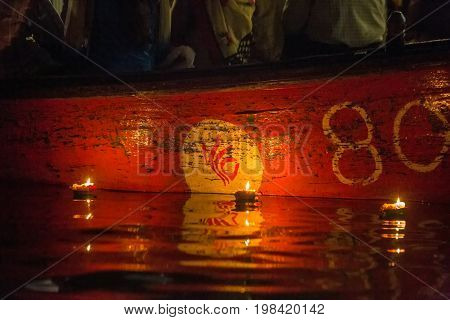Varanasi burning candles floating in the Ganges river, India.