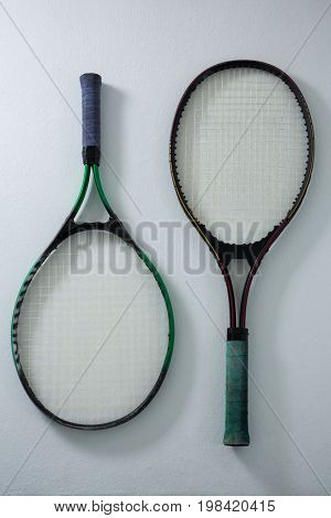 Overhead view of tennis rackets on white background