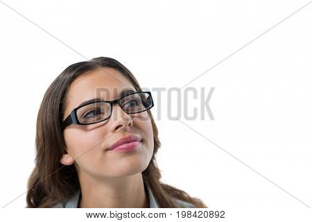Close-up of thoughtful female executive looking up and smiling