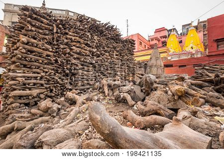 Pile of wood used at ghats crematorium of Varanasi, India. Shot with DOF.