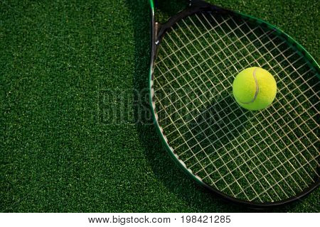 High angle view of tennis ball on racket at field