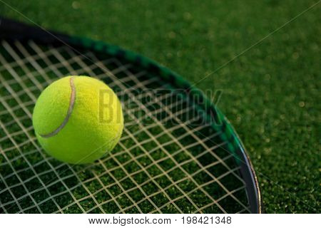 Close up of tennis ball on racket at field