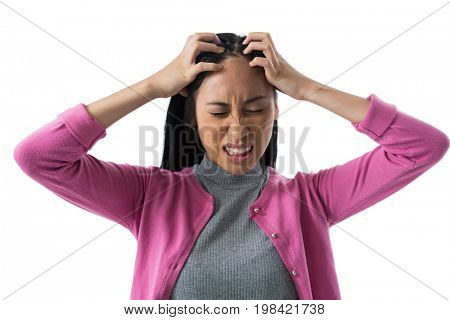 Depressed woman standing against white background