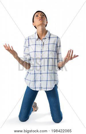 Worried businesswoman praying against white background