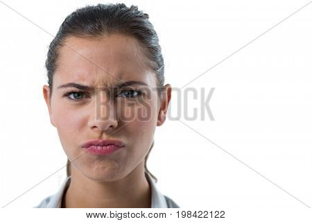 Portrait of confused female executive against white background