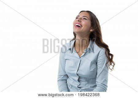 Beautiful female executive smiling against white background