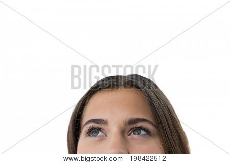 Close-up of thoughtful woman against white background