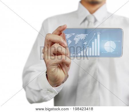 Growing bar graph, line chart, pie chart and world map on blue touch screen mobile phone, in businessman's hand. Financial, banking and technology concept