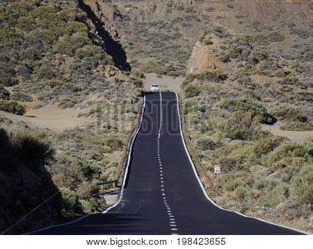 Empty endless highway through the volcanic landscape of Lanzarote island, Canary islands, Spain