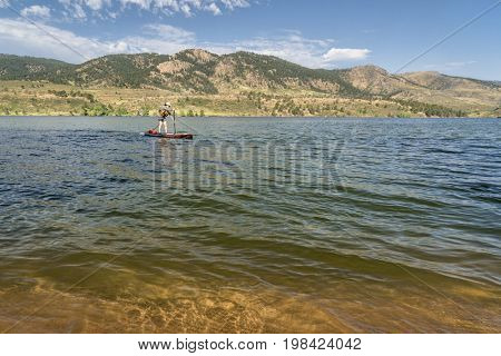 summer recreation on Horsetooth Reservoir in northern Colorado - paddling stand up paddleboard