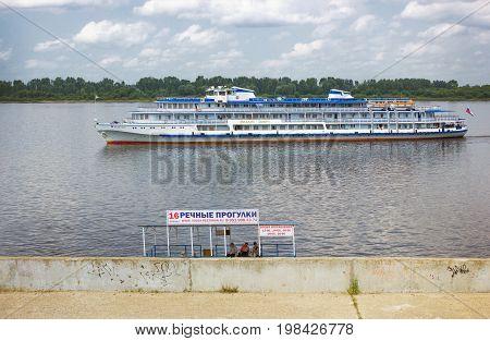RUSSIA NIZHNY NOVGOROD - JUL 28 2017: River cruise ship sailing along the Volga embankment