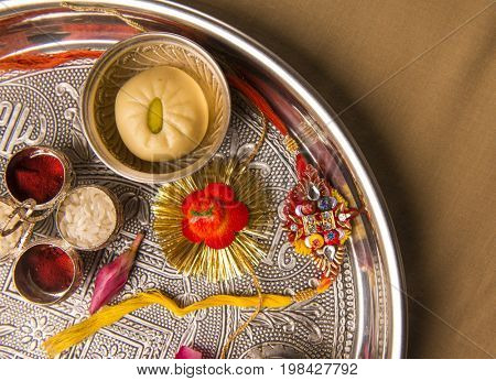 A Rakhi - traditional wrist band, placed in a decorative pooja thali.