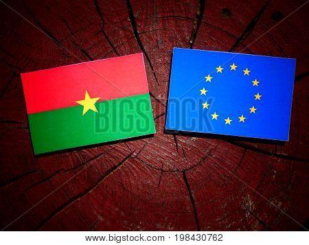 Burkina Faso Flag With Eu Flag On A Tree Stump Isolated