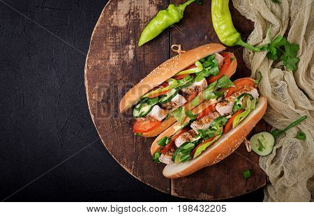 Big Sandwich With Chicken Breasts, Tomato, Cucumber And Herbs. Flat Lay. Top View