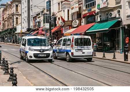 Editorial image of two Fatih district police cars blocking the street in the middle of the day in Istanbul, Turkey on June 15, 2017.
