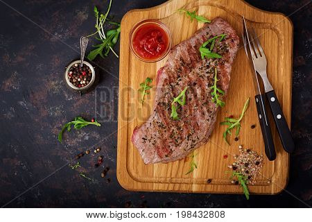 Juicy Steak Rare Beef With Spices On A Wooden Board. Top View. Flat Lay.