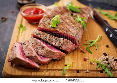 Juicy Steak Rare Beef With Spices On A Wooden Board