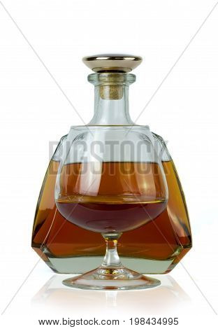 bottle of brandy with brandy poured in a glass