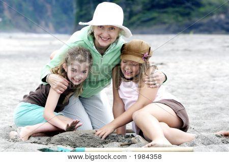 Grandma And Her Precious Grandaughters At The Beach