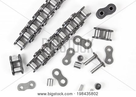 details of industrial driving roller chain on white background