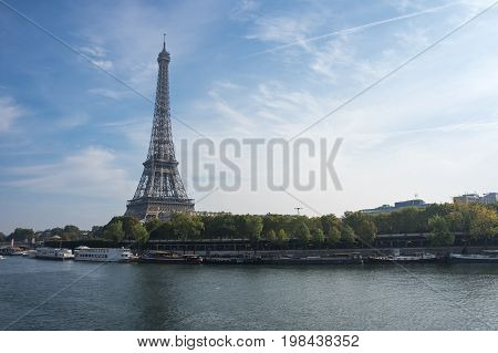 View from river Seine at famous Tour Eiffel in sunny autumn day Paris France