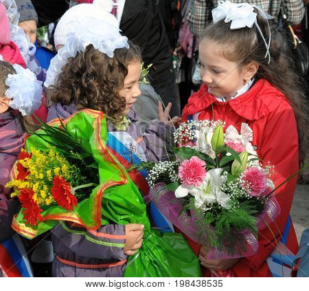 Gajievo, Russia - September 01, 2010: First-graders with flowers on the feast of the first of September