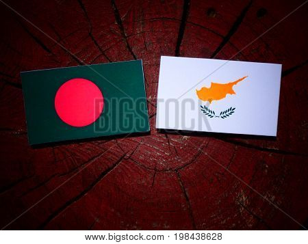 Bangladesh Flag With Cypriot Flag On A Tree Stump Isolated