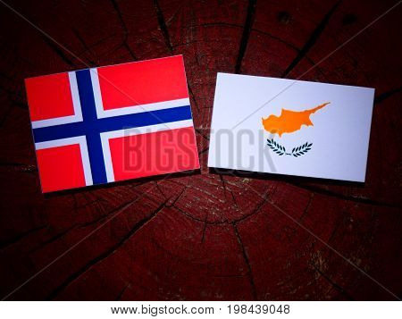 Norwegian Flag With Cypriot Flag On A Tree Stump Isolated