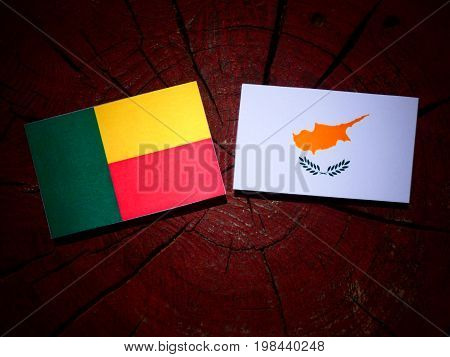 Benin Flag With Cypriot Flag On A Tree Stump Isolated