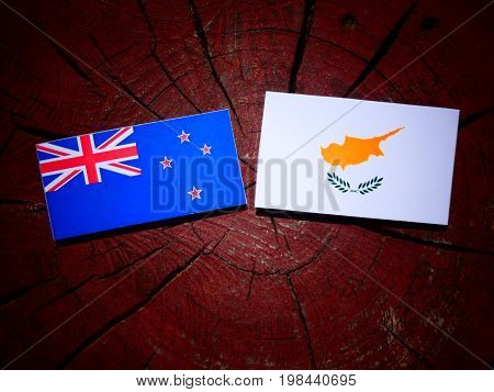 New Zealand Flag With Cypriot Flag On A Tree Stump Isolated