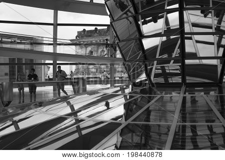 BERLIN GERMANY - AUGUST 7 2015 - the famous viewing Dome of the Reichstag in the form of a funnel with increasing height expands up to 16 m in diameter the play of light caused by the reflection mirrors 360