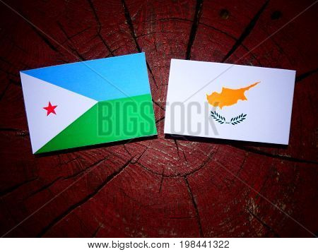 Djibouti Flag With Cypriot Flag On A Tree Stump Isolated