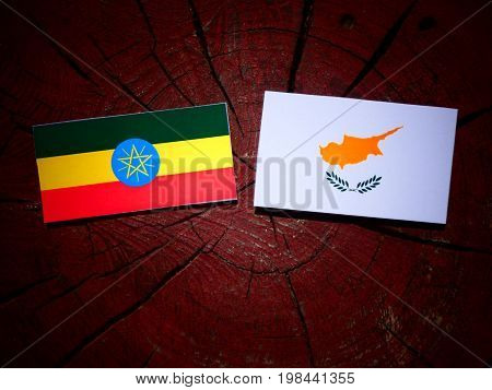 Ethiopian Flag With Cypriot Flag On A Tree Stump Isolated
