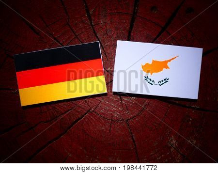 German Flag With Cypriot Flag On A Tree Stump Isolated