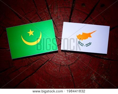 Mauritania Flag With Cypriot Flag On A Tree Stump Isolated