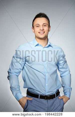 Young handsome man on gray background