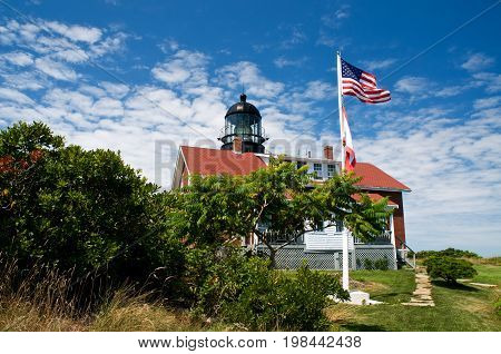 Flag waves over Seguin Island light, which is Maine's most powerful lighthouse. It has the largest first order Fresnel lens, and is also considered to be haunted.