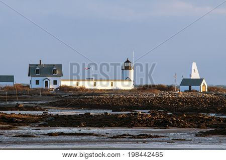Maine's Goat Island Lighthouse guides mariners into the harbor even during low tide.