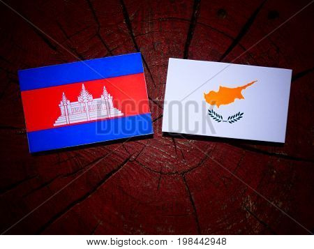 Cambodian Flag With Cypriot Flag On A Tree Stump Isolated