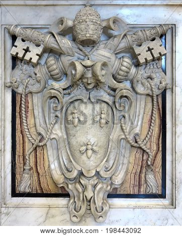 19.06.2017 Vatican City: Coat of arms of the Vatican symbol bas-relief in of St. Peters Basilica