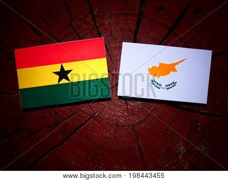 Ghanaian Flag With Cypriot Flag On A Tree Stump Isolated