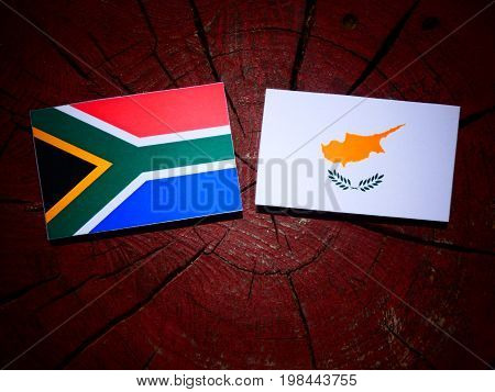 South African Flag With Cypriot Flag On A Tree Stump Isolated