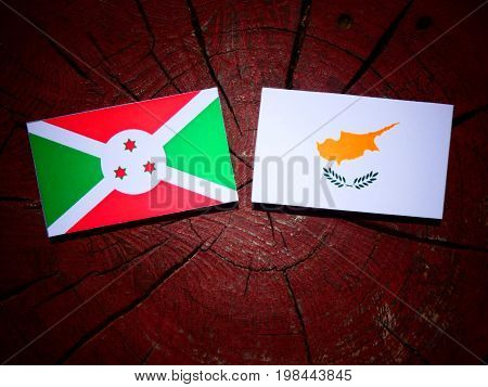 Burundi Flag With Cypriot Flag On A Tree Stump Isolated