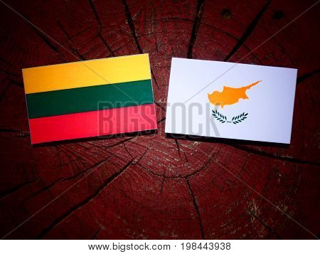 Lithuanian Flag With Cypriot Flag On A Tree Stump Isolated
