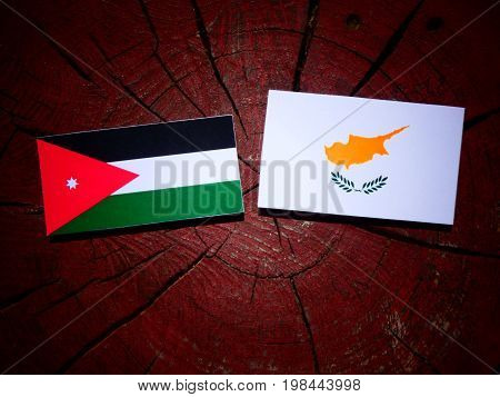 Jordanian Flag With Cypriot Flag On A Tree Stump Isolated