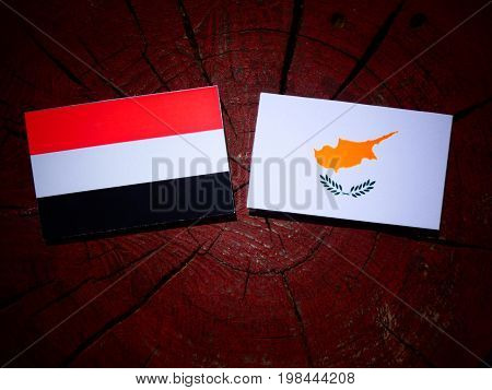 Yemeni Flag With Cypriot Flag On A Tree Stump Isolated